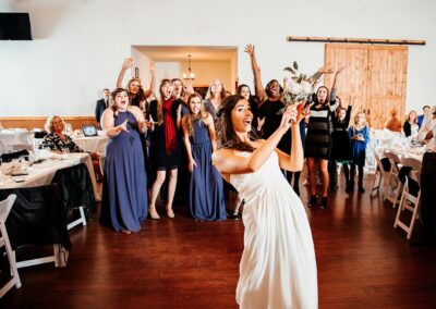 There was plenty of excitement when this bride started her bouquet toss. Image by 28 North Photography, www.28north.co.