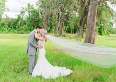 Lush grass, trees and wide open spaces provide the perfect backdrop for wedding-day portraits.