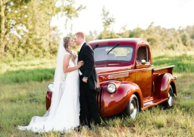 The bride arrived at the wedding ceremony site in this antique truck. After the reception, the couple used it as their getaway vehicle. Photo by AmberDornPhotography.com.