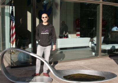 Domenic Esposito with the Johnson and Johnson Spoon, as installed at the entrance to Johnson and Johnson HQ, New Brunswick