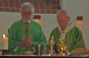 The church's pastor Fr. Bezikhofer ,left, with Archbishop Thissen