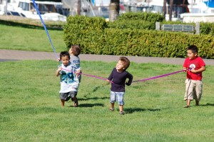 Lummi kids grabbing the kite's tail