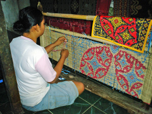 Wrapping thread with plastic tape, prior to dying,Teganan, Bali