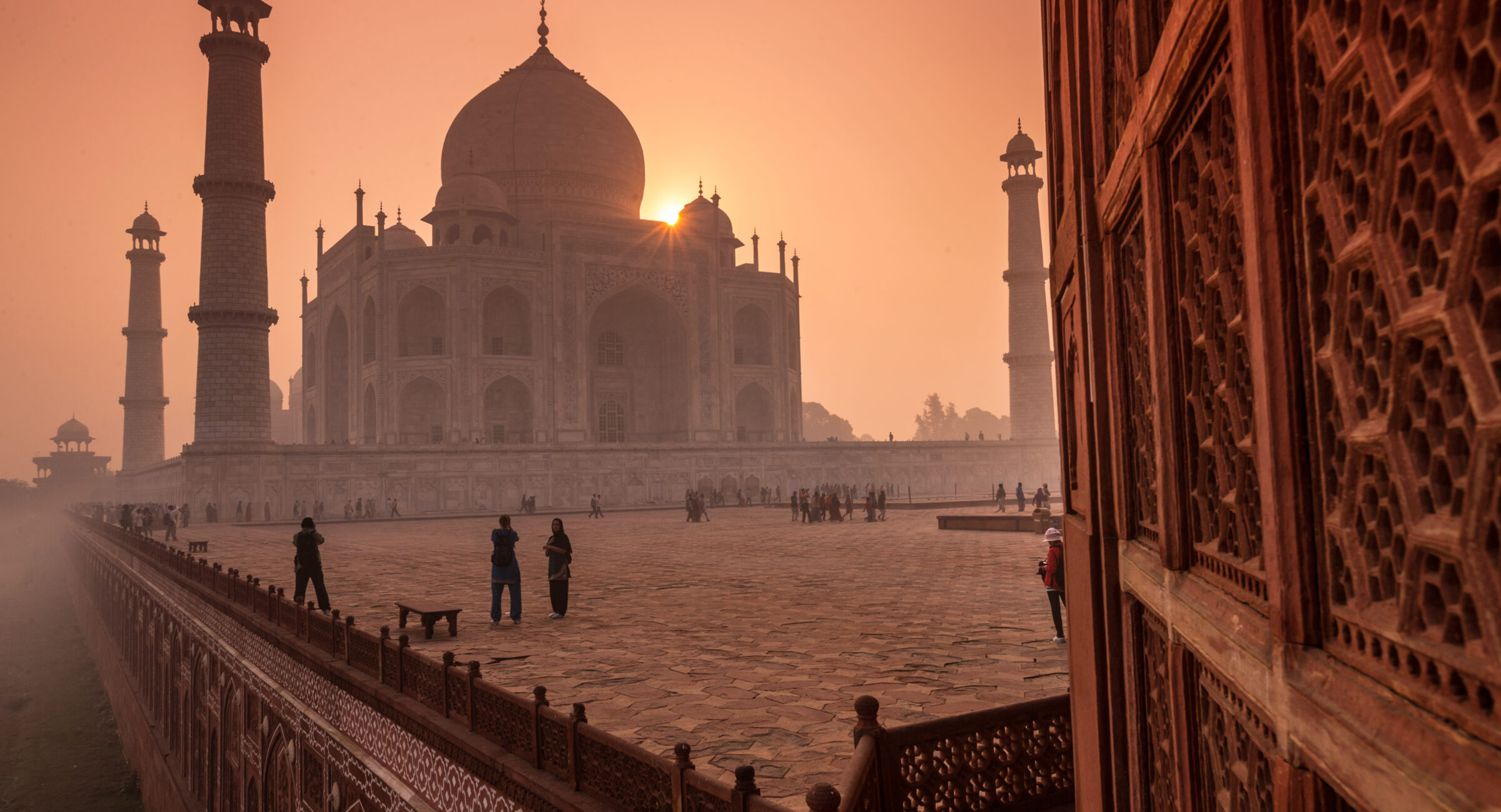 People visiting the magnificent Taj Mahal in Agra, India