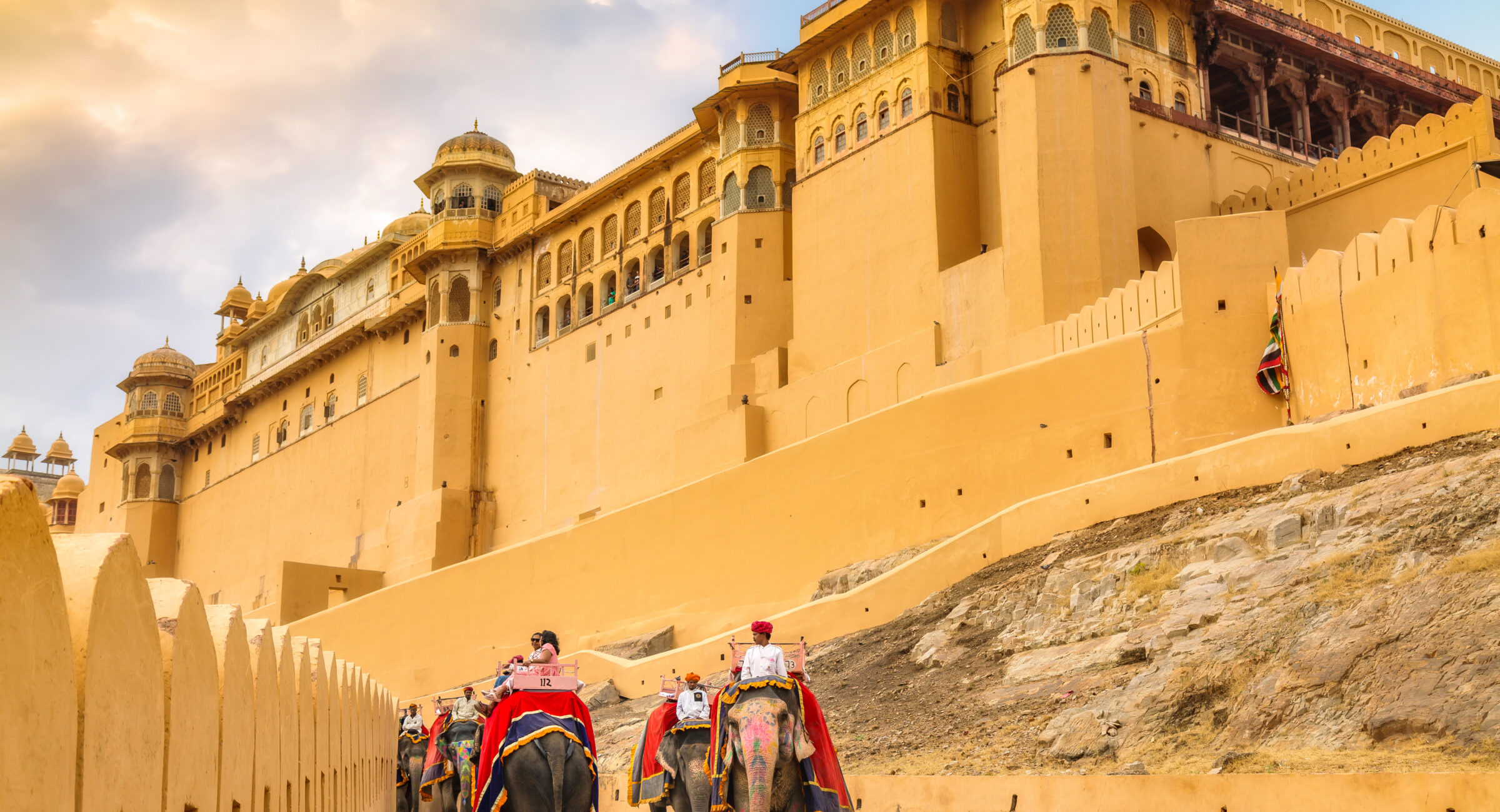 Jaipur, Rajasthan, India, December 11,2017: Tourists enter the historic Amber Fort Jaipur on decorated Indian elephants. Amber Fort is a UNESCO World Heritage site.