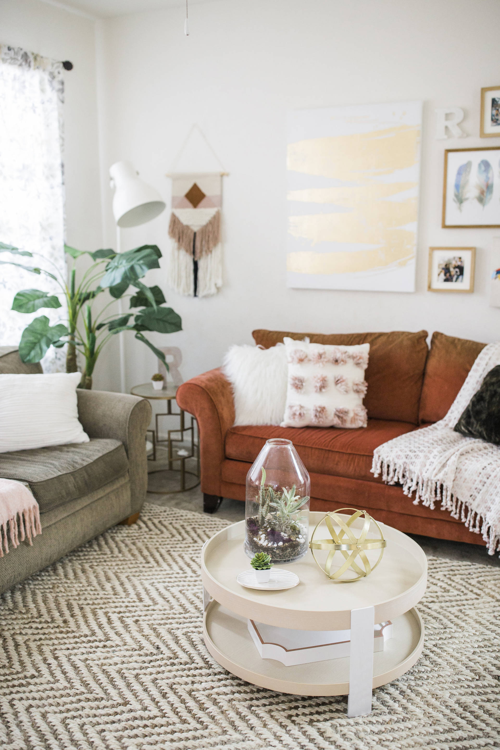 My complete living room make over is finally here! We spruced up the space with the same couches and few key items such a new rug and wall decor!