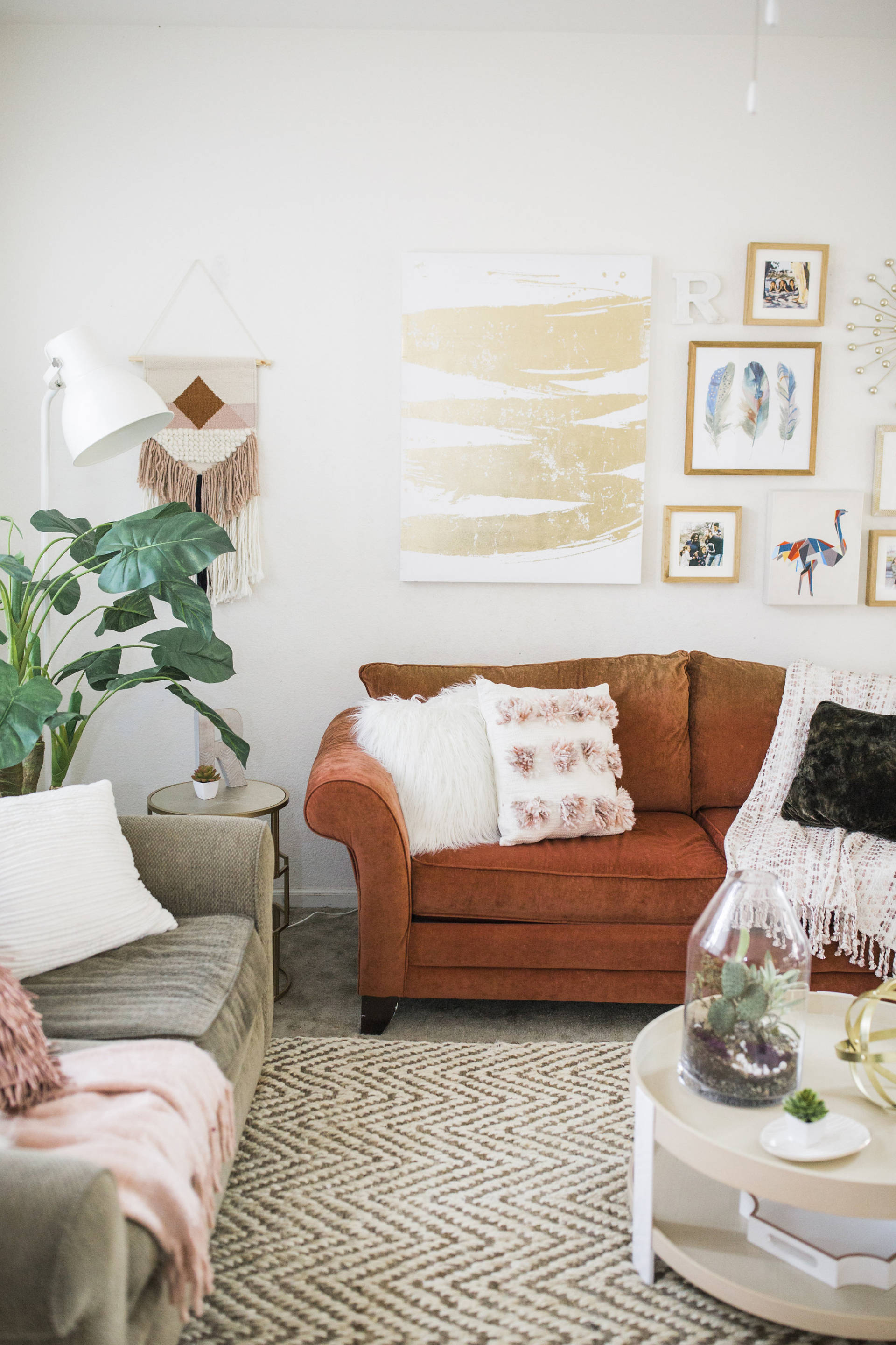 My complete living room make over is finally here! We spruced up the space with the same couches and few key items.