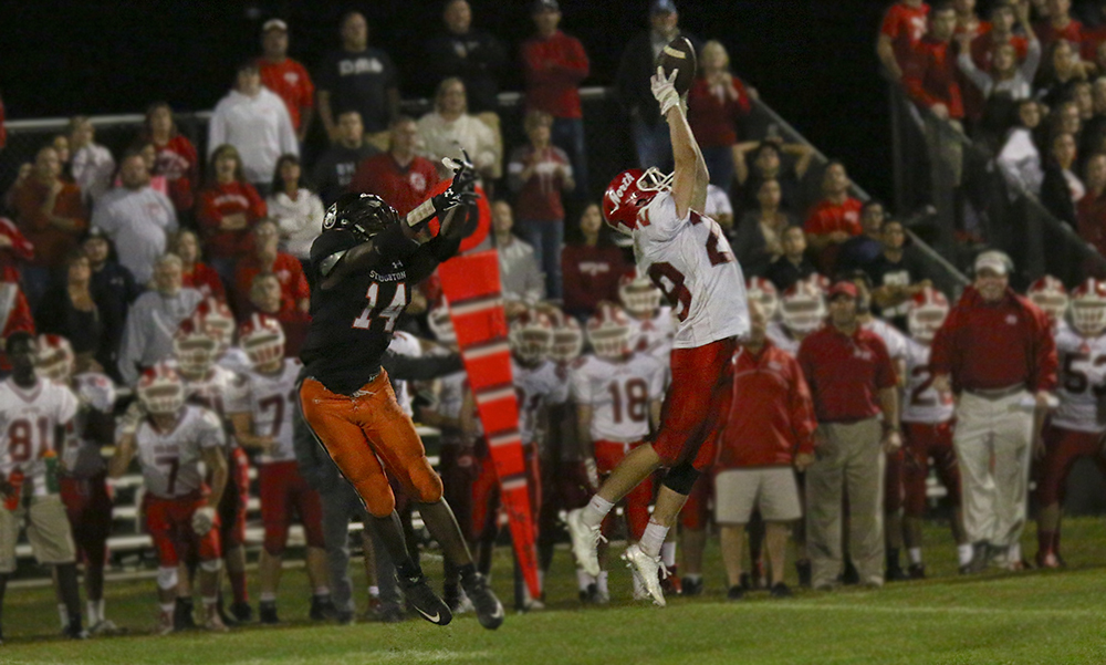 North Attleboro's Nick Gaumond intercepts a pass in the second half that he eventually returned 49 yards for a touchdown. (Jeffrey Pickette/Stoughton Media Access)