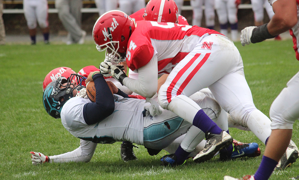 North Attleboro's Thomas Reynolds (#54) tackles a Franklin running back in the first half. (Ryan Lanigan/HockomockSports.com)