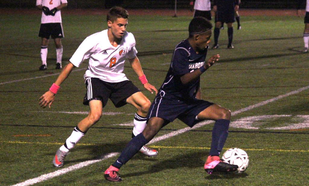 Foxboro's Devante Teixeira attempts to dribble around Oliver Ames' Matt Campbell. (Ryan Lanigan/HockomockSports.com)
