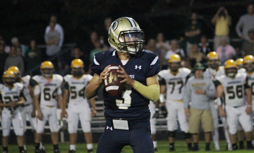 Foxboro's Mark Clagg rushed for one touchdown and threw another to lead the Warriors. (Ryan Lanigan/HockomockSports.com Stock Photo)