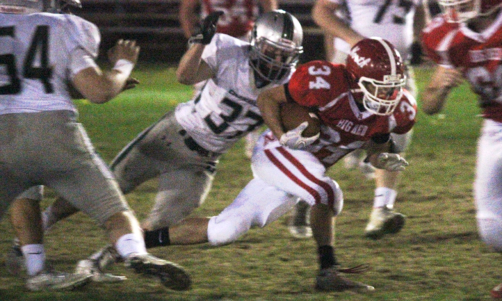 North Attleboro's Nick Rajotte carries the ball in the first half against Duxbury. (Ryan Lanigan/HockomockSports.com)