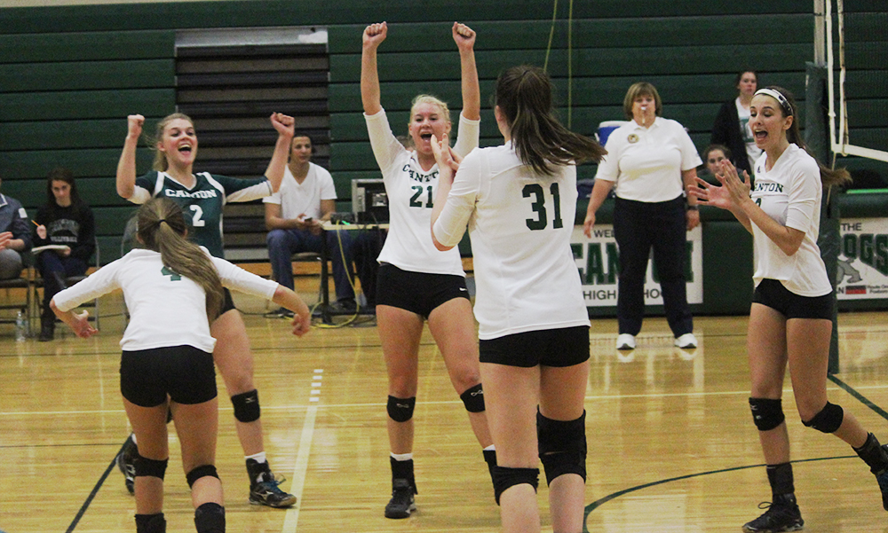 Canton celebrates after winning a long rally in the second set against Milton on Monday night. (Ryan Lanigan/HockomockSports.com)