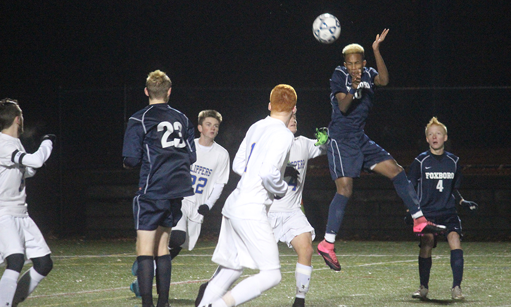 Foxboro's Devante Teixeira rises up for a header in the second half against Norwell. (Ryan Lanigan/HockomockSports.com)