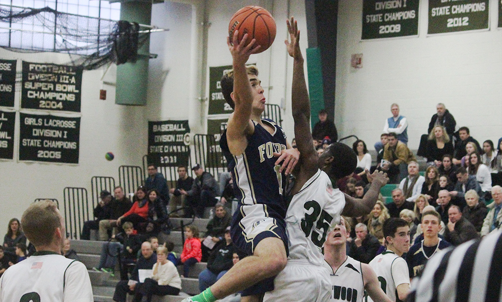 Foxboro's Jason Procaccini (career-high 25 points) drives to the basket against Westwood in the first half. (Ryan Lanigan/HockomockSports.com)