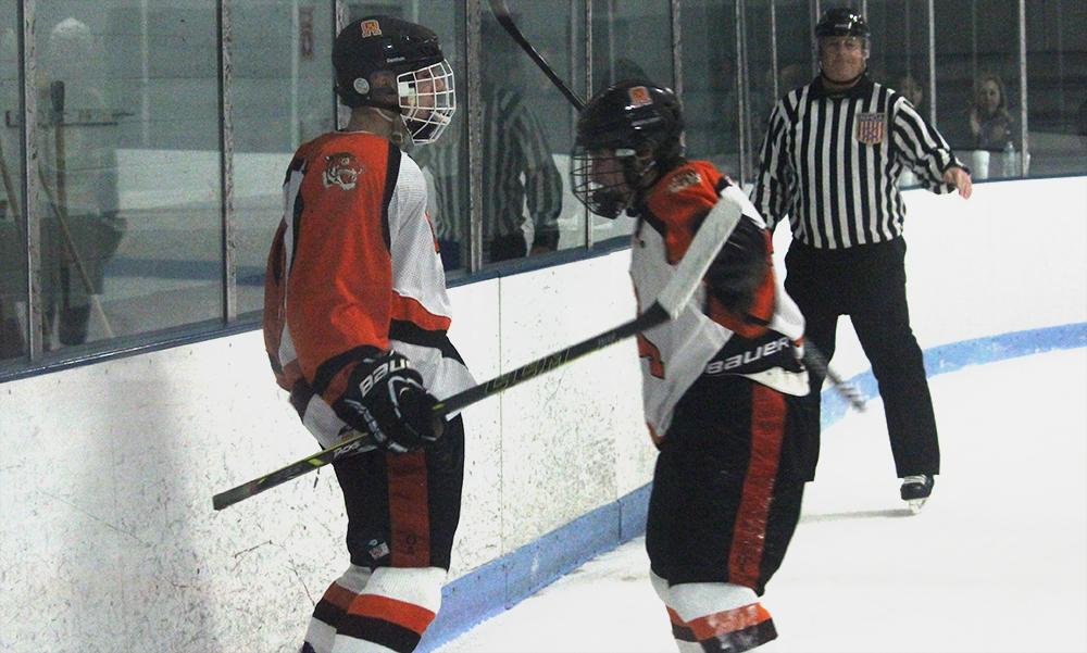 Oliver Ames' Matt Mancini (left) and Owen Gallagher celebrate after scoring a shorthanded goal in the third period. (Ryan Lanigan/HockomockSports.com)