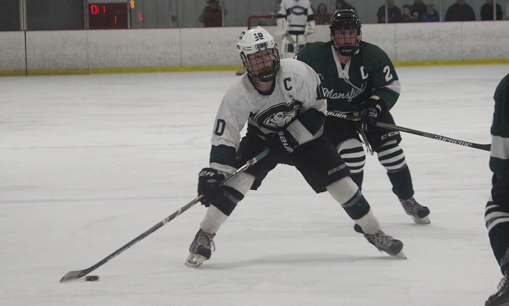 Canton's Bobby Mullaney looks to shoot in the third period against Mansfield on Saturday evening. (Ryan Lanigan/HockomockSports.com)