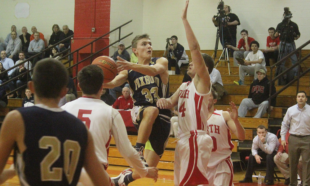 Foxboro's Mark Clagg drives to the basket in the first half against North Attleboro. (Ryan Lanigan/HockomockSports.com)