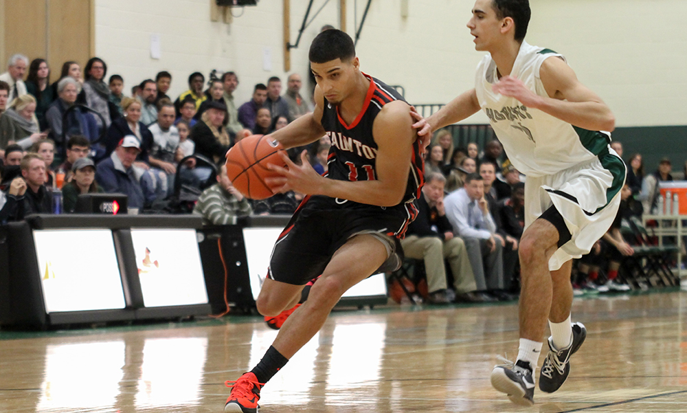 Taunton senior Jose Merardo dribbles around a defender in the first half against Mansfield. (Tom Madigan/Photo).