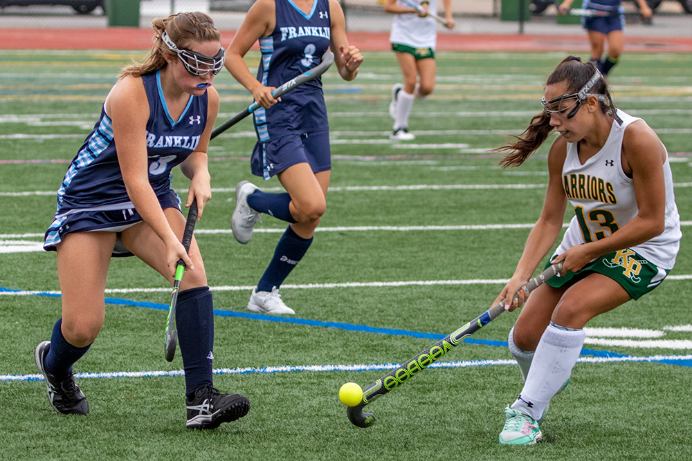 Franklin's Amanda Lewandowski and King Philip's Christina Gifun battle for possession in the second half. (Ryan Lanigan/HockomockSports.com)