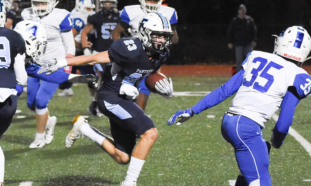 Jake Davis (23) and the Franklin offense struggled to get going against Attleboro but managed to score twice in the second half to secure a 14-0 win. (Josh Perry/HockomockSports.com)