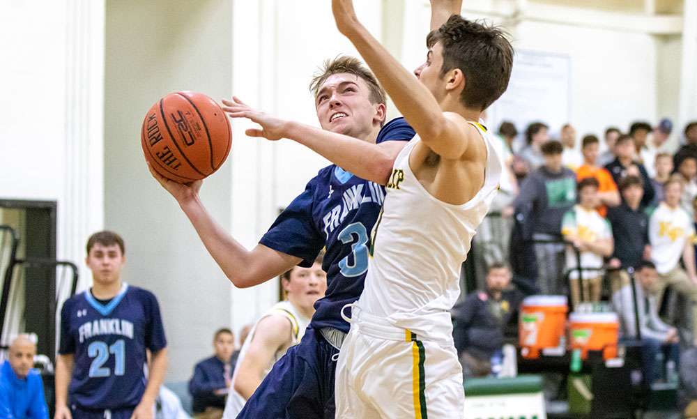 Franklin senior Chris Edgehill goes up for a shot in the second half against King Philip's Alex Fritz. (Ryan Lanigan/HockomockSports.com)