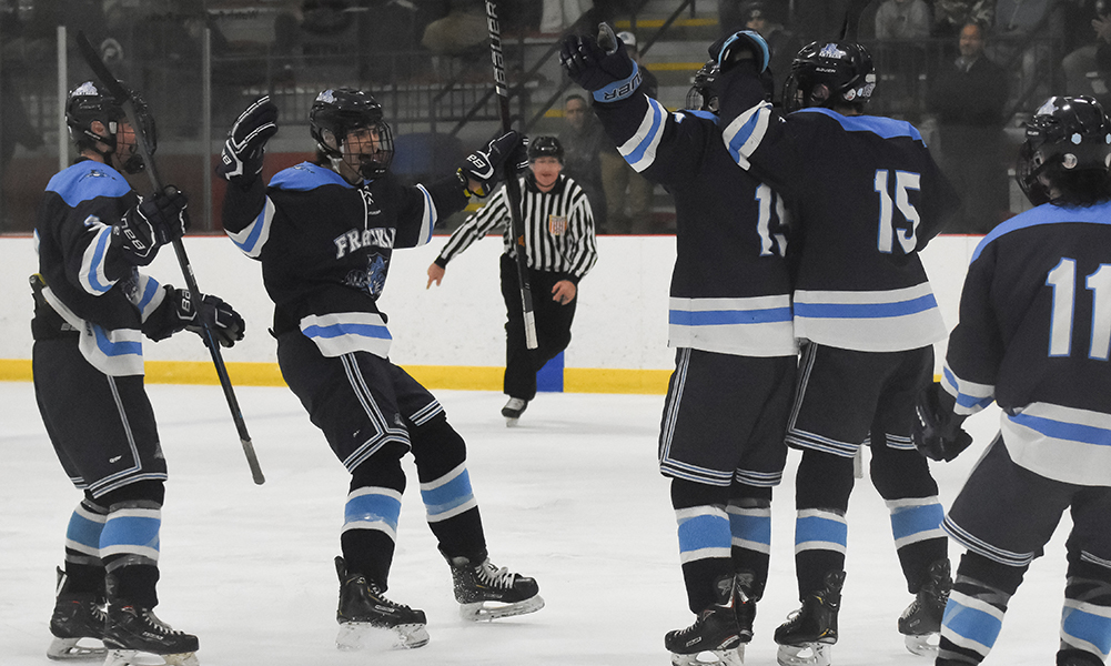 Franklin celebrates one its two second period goals in a dominating 7-1 win against King Philip in the playoff opener. (Josh Perry/HockomockSports.com)