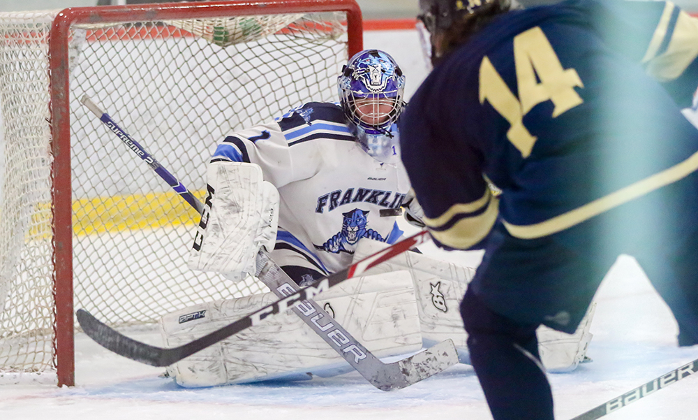 Franklin senior goalie Ray Ivers makes a save on a shot from Archbishop Williams' Alex Umbro in the second period. (Ryan Lanigan/HockomockSports.com)