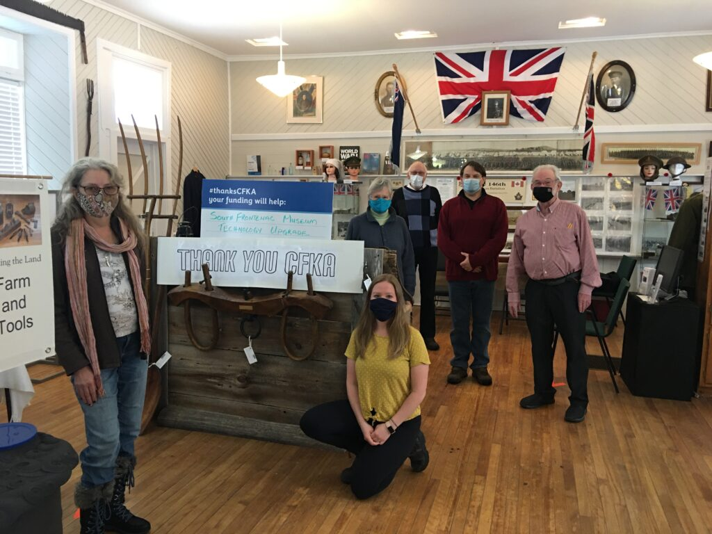 Museum Society Members with thank you CFKA sign