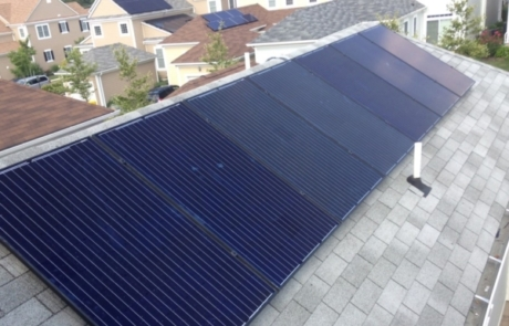 Solar Panels on Grey Roof with Solar Homes in Back