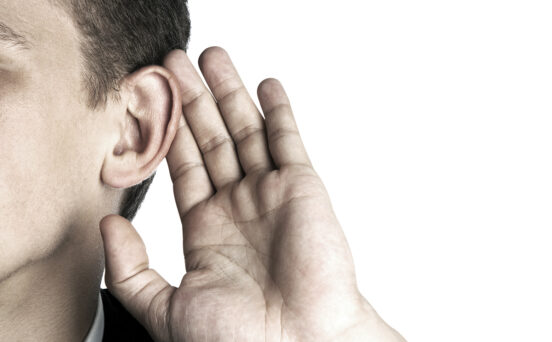 photo of person listening hand to ear