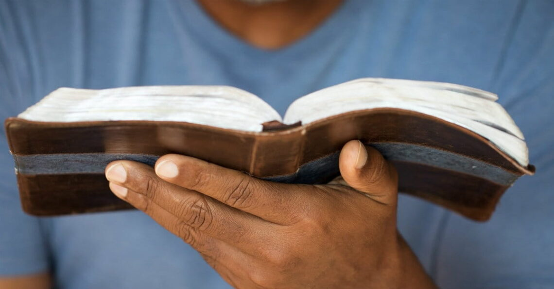photo of person holding a Bible in their hand