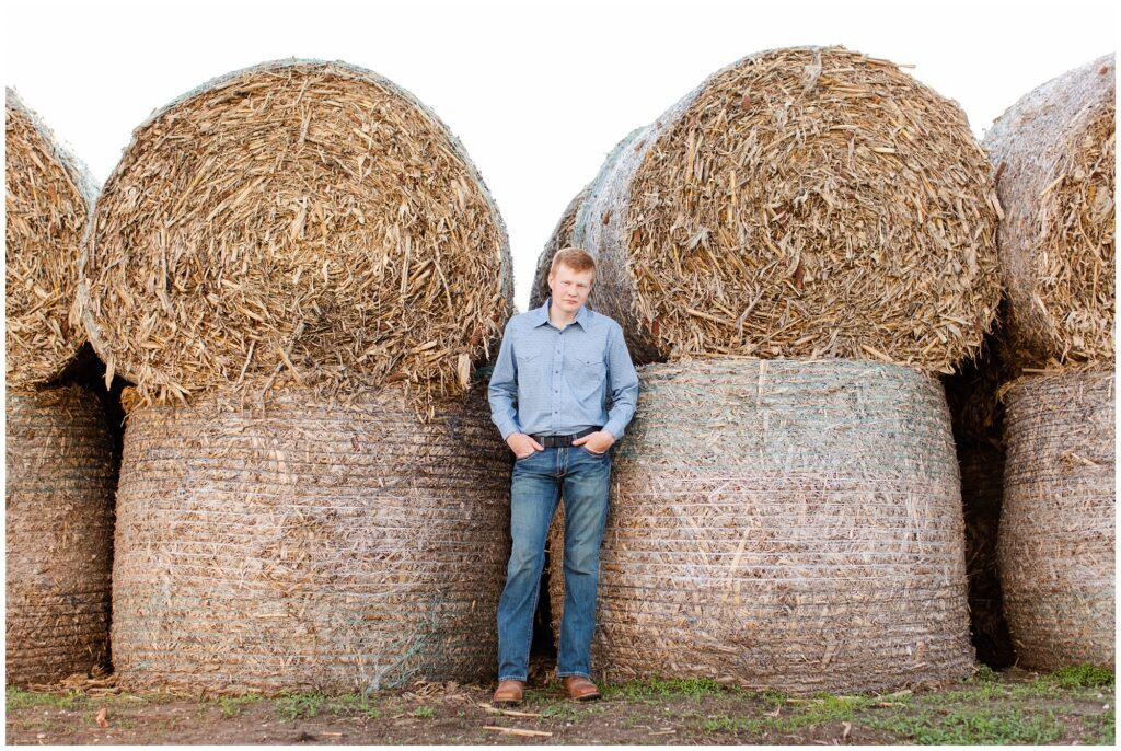 Senior photo on hay bales | Farm senior session | Iowa Senior Photographer | CB Studio