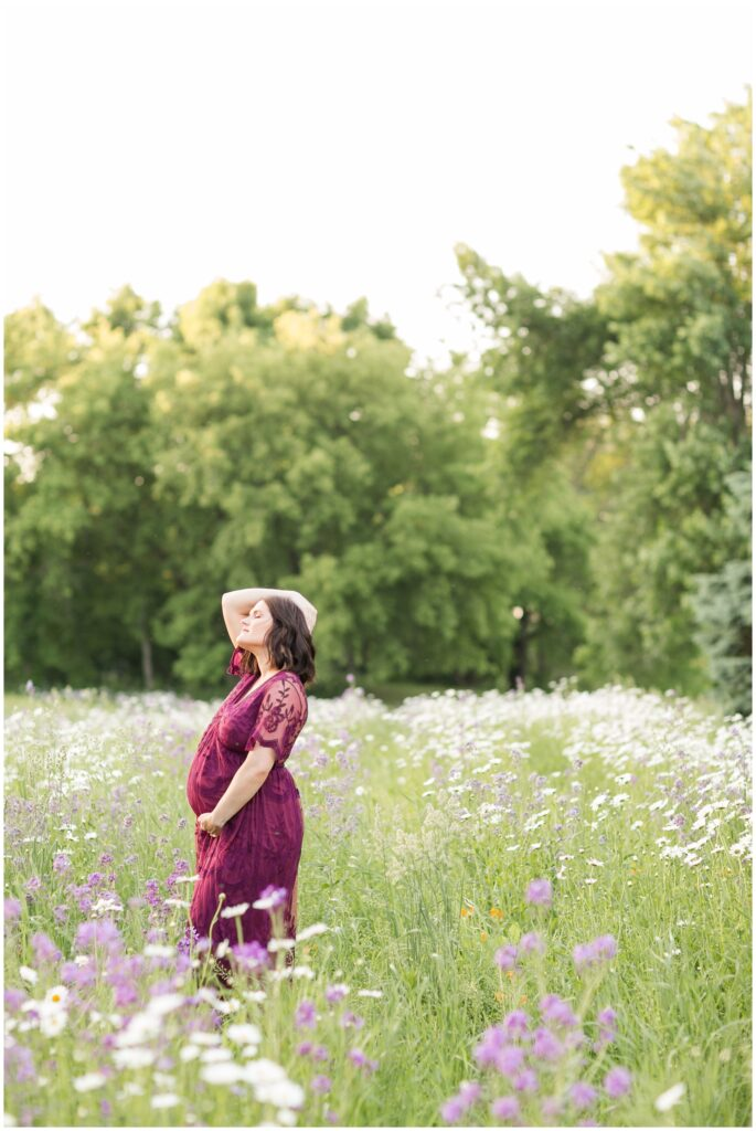 Maternity session in a flower pasture | Maternity Poses | Iowa Maternity Photographer | CB Studio