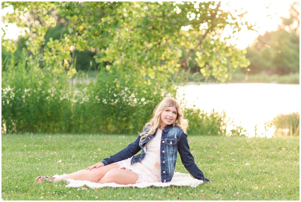 Senior portrait session at a park during golden hour | Senior girl poses by a lake | Iowa Senior Photographer | CB Studio