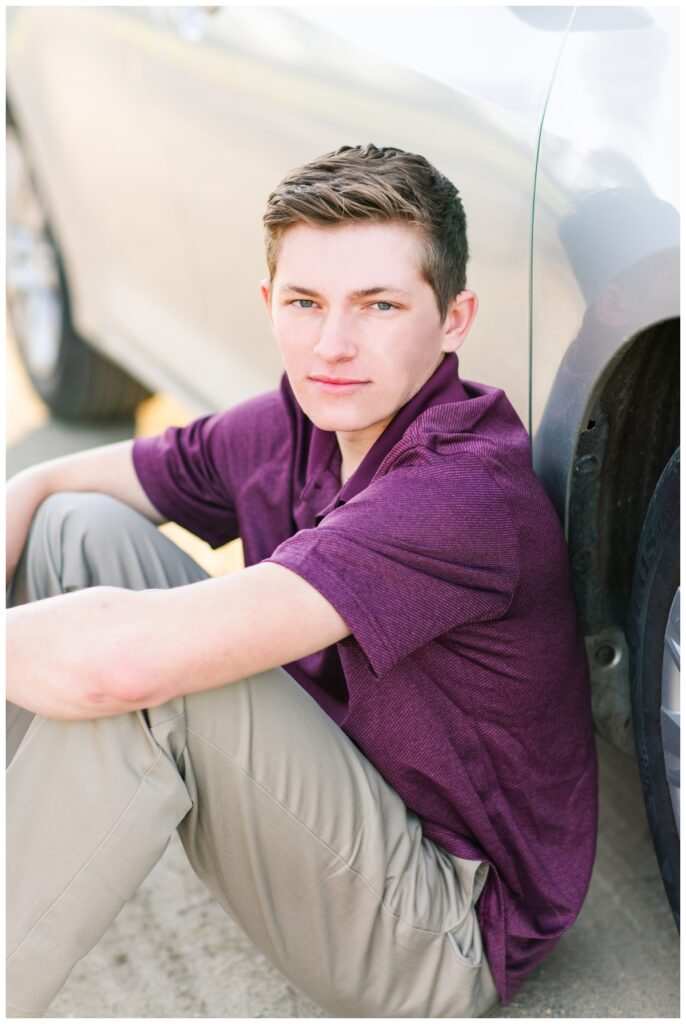 Fall senior boy session sitting next to a car | Iowa Senior Photographer | CB Studio