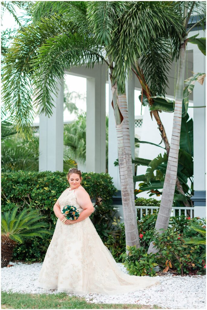 Bride posing with green and gold bouquet at The Godfrey Hotel Tampa | Tampa Bay Wedding | CB Studio
