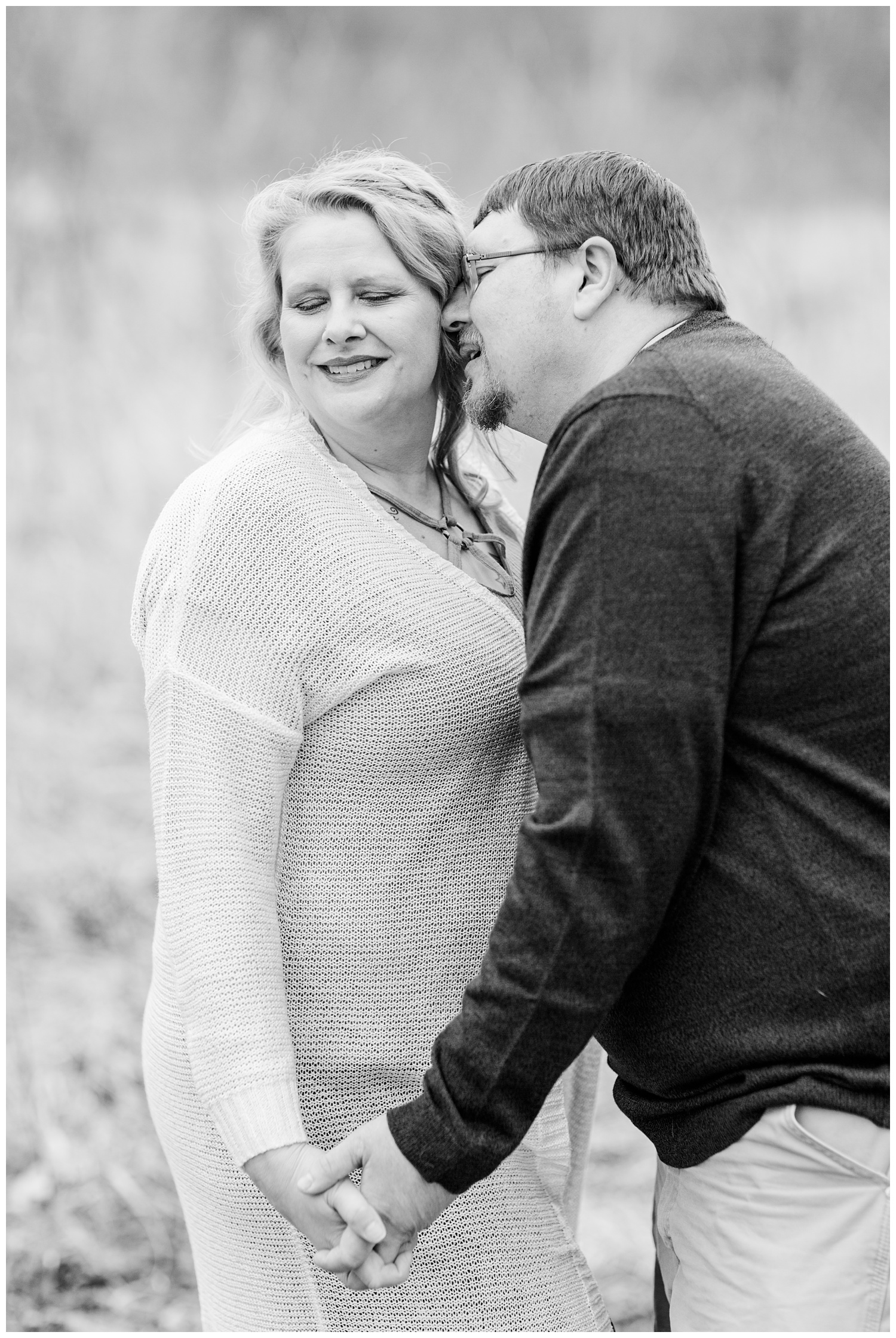 Engagement shoot in a grassy pasture in central Iowa in mid-March