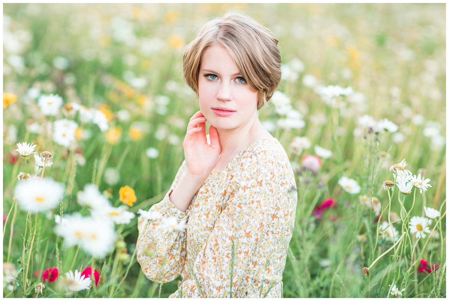 Vintage, film inspired, 70s retro styled senior photoshoot at golden hour in a floral field. | CB Studio
