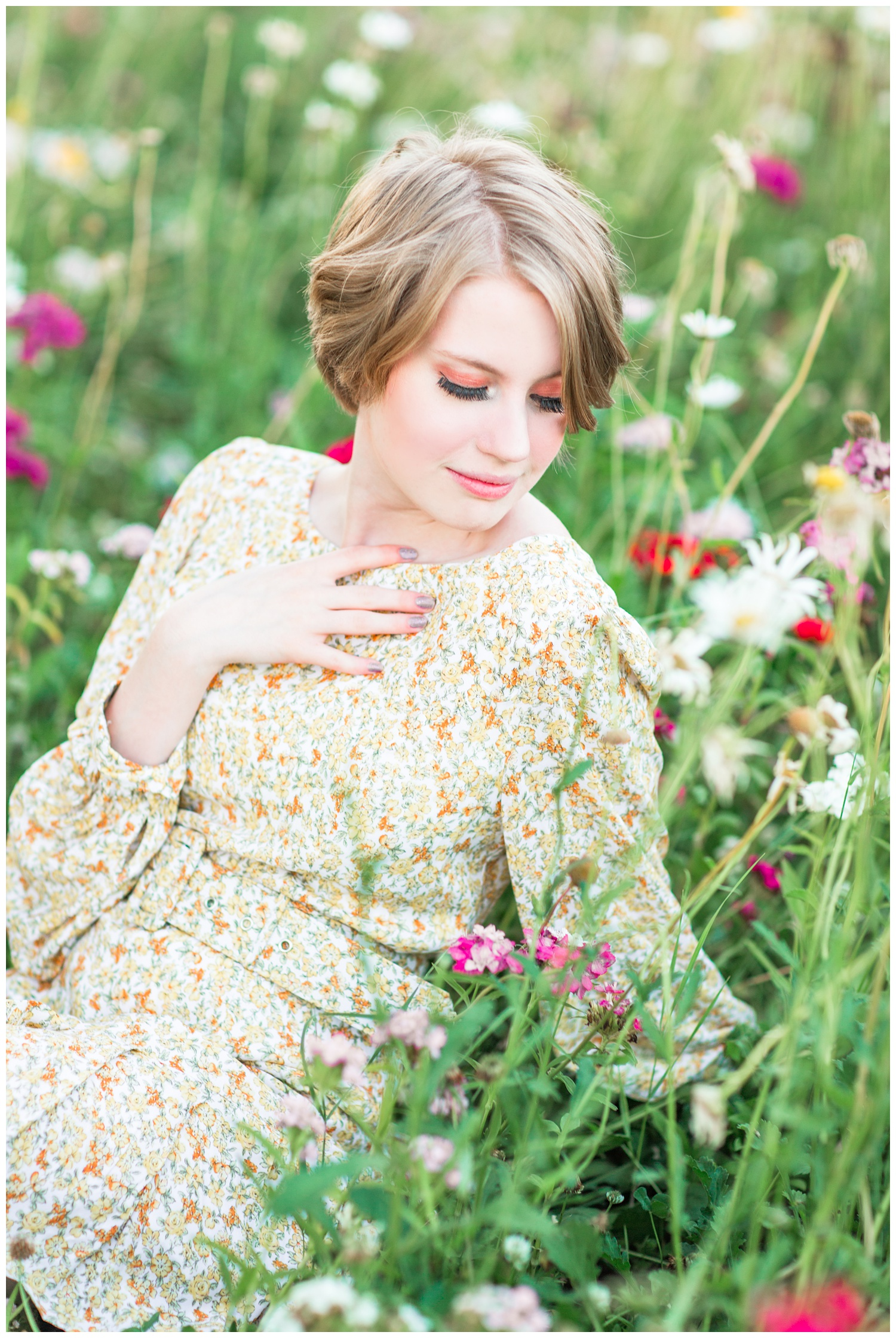 Vintage, film inspired, 70s retro styled senior photoshoot at golden hour in a flower field. | CB Studio