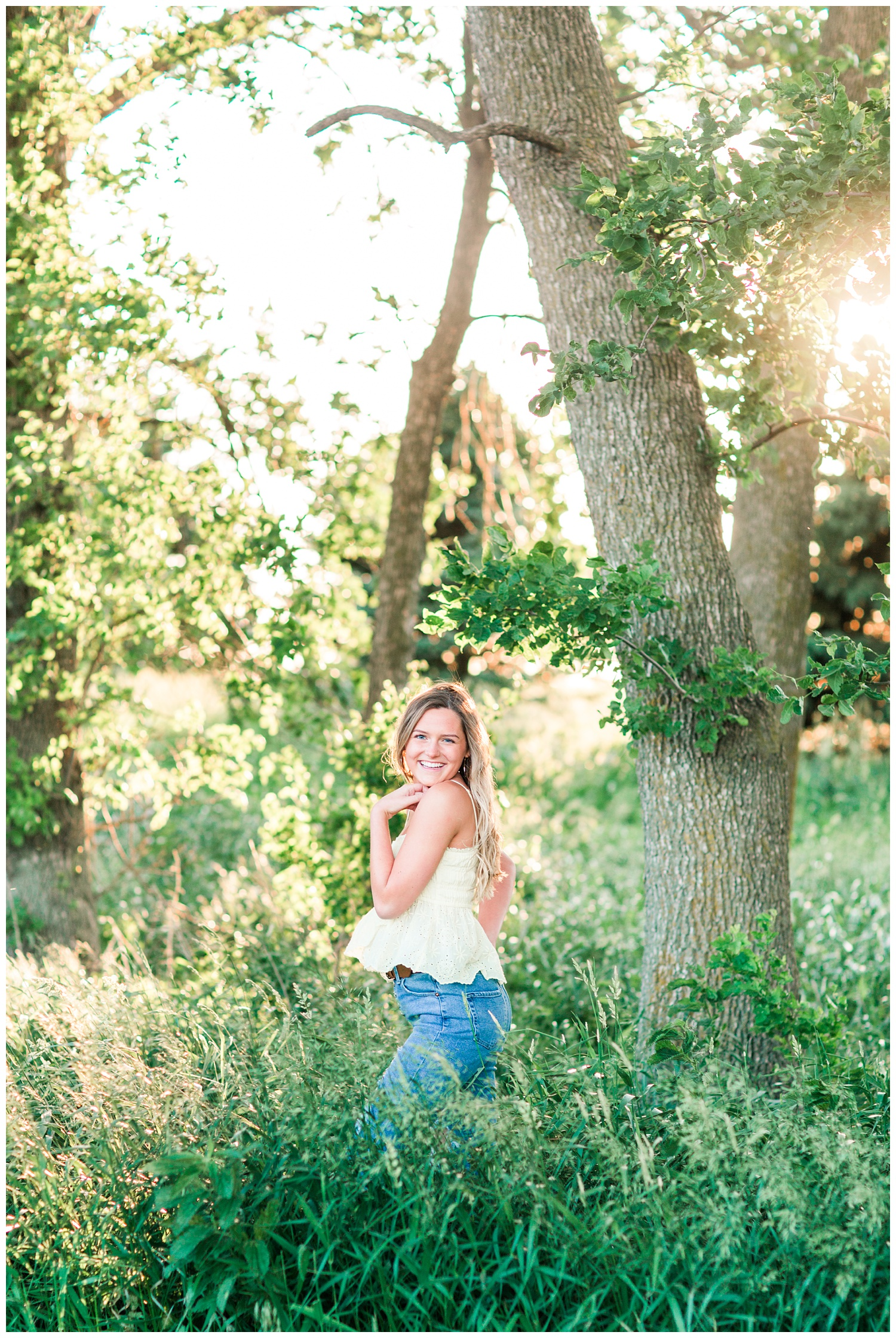 Senior girl posing in a grassy field | CB Studio