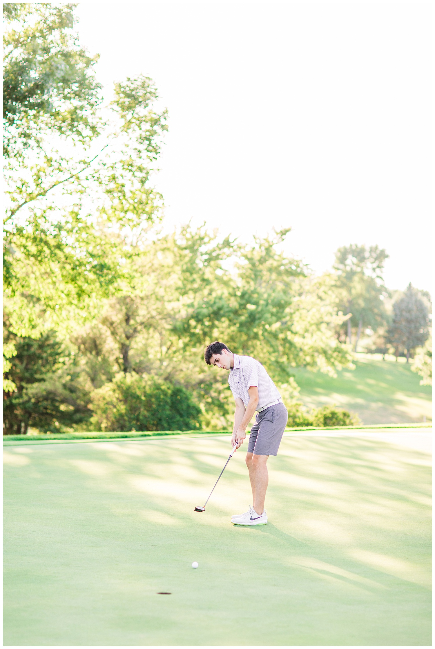 High school senior boy putting a golf ball at Spring Vally Golf Course in Livermore, Iowa | CB Studio