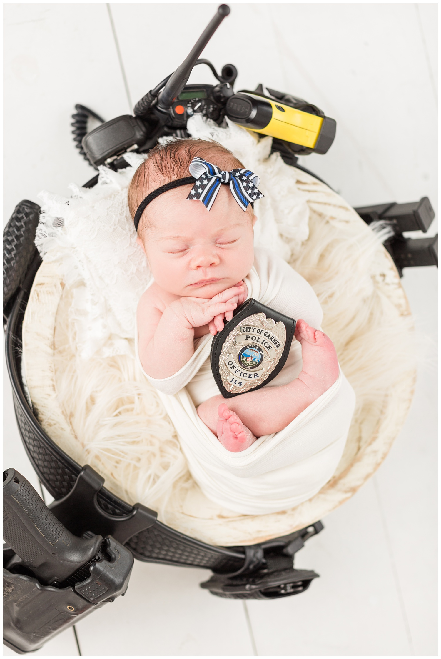 Thin Blue Line police support newborn baby girl wrapped in white supports her daddy who is a police officer in Garner, Iowa   CB Studio
