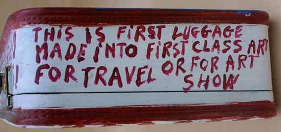 """detail edge side Suitcase (American Flag & Cherokee Love Birds) dated 11-1-92 by B. F. Perkins acrylic on suitcase 17"""" x 21"""" x 6"""" $1000 (11325)"""