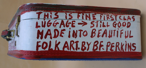 """detail edge side 2 Suitcase (American Flag & Cherokee Love Birds) dated 11-1-92 by B. F. Perkins acrylic on suitcase 17"""" x 21"""" x 6"""" $1000 (11325)"""