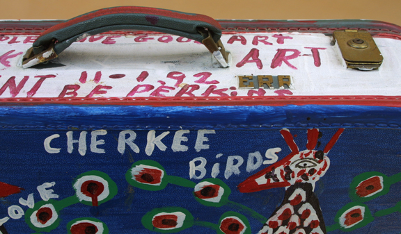 """detail 2 top Suitcase (American Flag & Cherokee Love Birds) dated 11-1-92 by B. F. Perkins acrylic on suitcase 17"""" x 21"""" x 6"""" $1000 (11325)"""