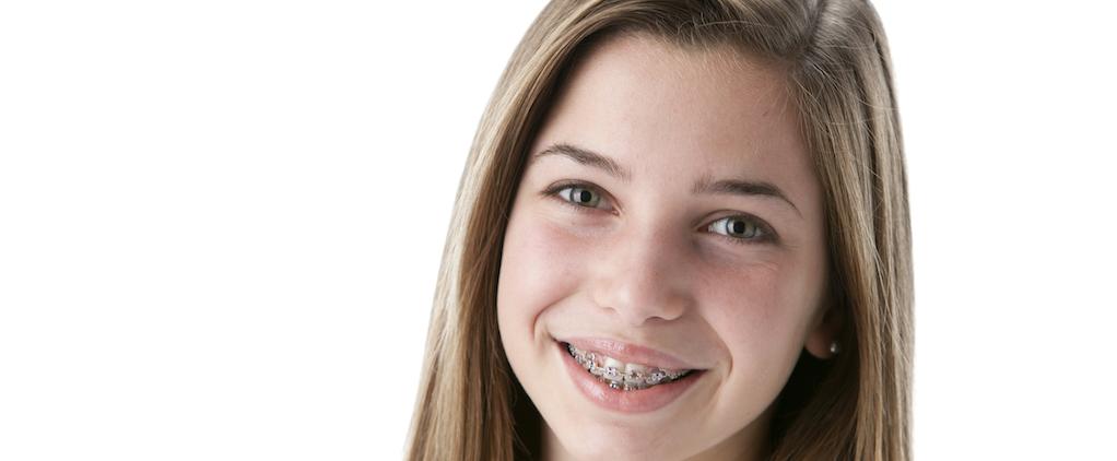 smiling teenage girl with braces