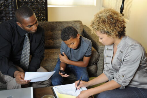 Mom and Dad discuss the family communication plan with their son. Credits: FEMA, Zachary Kittrie
