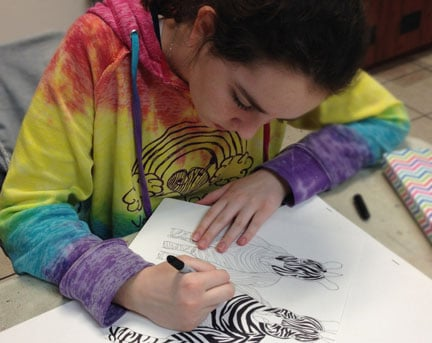 Learning how to draw in an summer art camp
