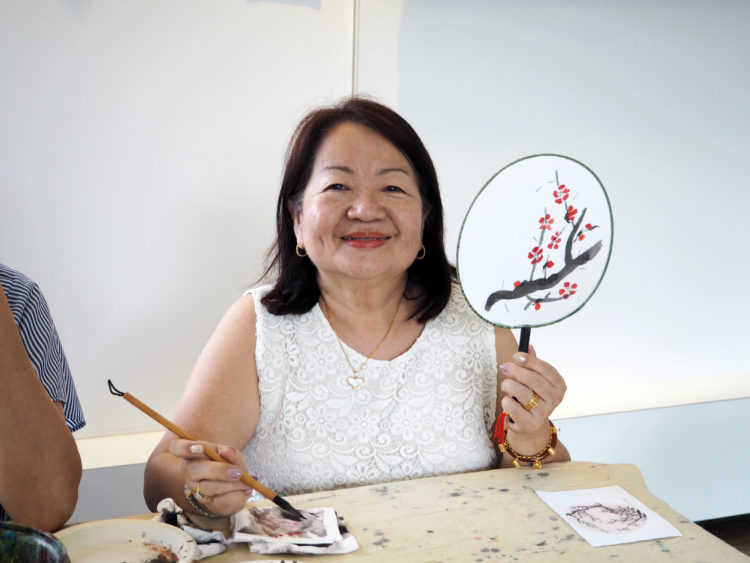 Chinese ink painting class at Visual Arts Centre, Student accomplishes her first work, learning Chinese brush painting on fan